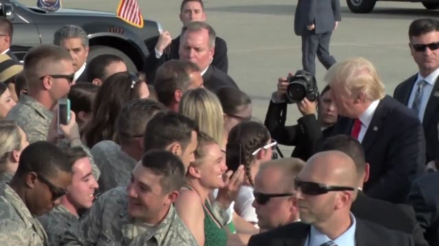 president donald trump walks over to unit and family members of the 193rd special operations wing - air force one stock videos & royalty-free footage