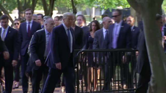 president donald trump walks through a park on his way to a photo op in front of st johns episcopal church in washington d.c. - photo call stock videos & royalty-free footage