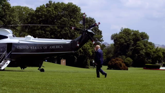 us president donald trump walks towards the marine one on the south lawn prior to his departure from the white house june 1 2018 in washington dc... - la casa bianca washington dc video stock e b–roll