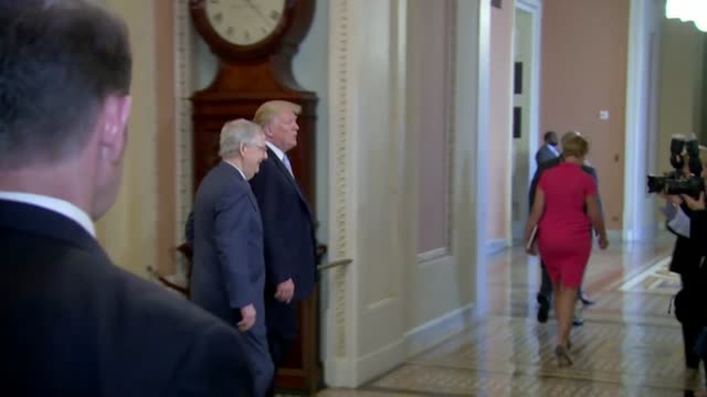 President Donald Trump walks with Senate Majority Leader Mitch McConnell by the Ohio Clock to a weekly luncheon meeting of Senate Republicans minutes...