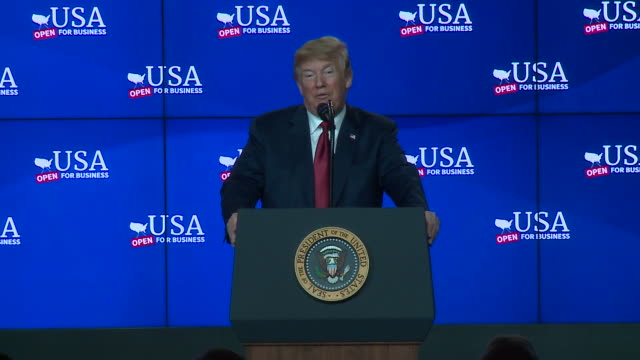 president donald trump was in wisconsin on june 28 at the groundbreaking for a $10 billion foxconn plant. trump was joined by house speaker paul ryan... - 関税点の映像素材/bロール
