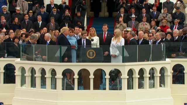 vídeos de stock, filmes e b-roll de president donald trump was sworn into office by chief justice of the united states john roberts at the inaugural ceremony on the west front of the... - tomada de posse