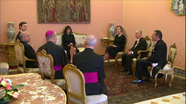 vídeos y material grabado en eventos de stock de president donald trump's daughter ivanka and first lady melania trump wait in small room with archbishops and papal security before meeting pope... - religion or spirituality