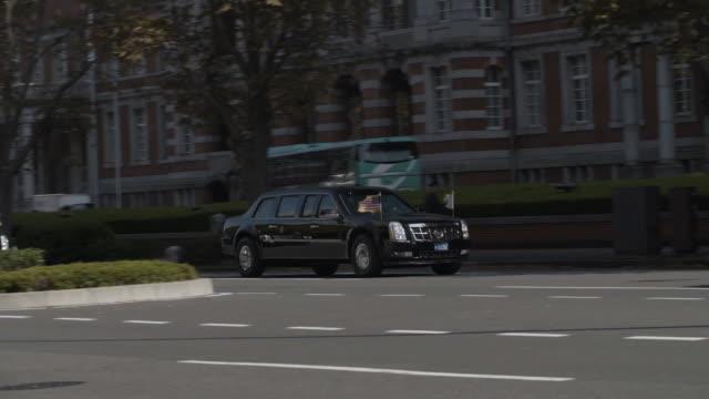 president donald trump's motorcade rides through tokyo - president stock videos & royalty-free footage