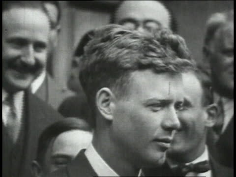 president doumergue awarding lindbergh the cross of the legion of honor then lindbergh visits nungesser and pose in front of the spirit of st louis... - 1927 stock videos & royalty-free footage