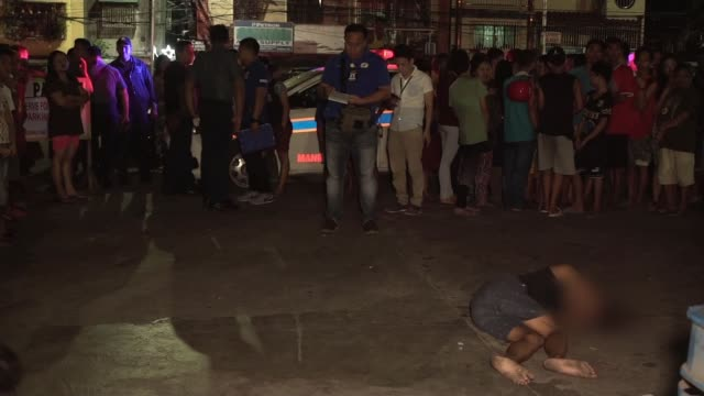 President Duterte serenades Donald Trump PHILIPPINES Manila Various shots of body of shooting victim lying in street with police in attendance and...