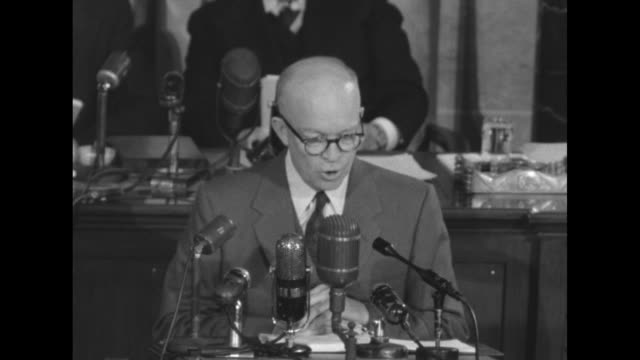 stockvideo's en b-roll-footage met president dwight d. eisenhower delivers state of the union address from podium in the well of the us house of representatives chamber; behind him sit... - 50 seconds or greater