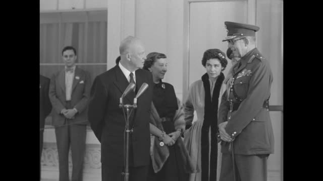 US President Dwight D Eisenhower First Lady Mamie Eisenhower Queen Frederica of Greece King Paul of Greece in front of White House entrance SOT...