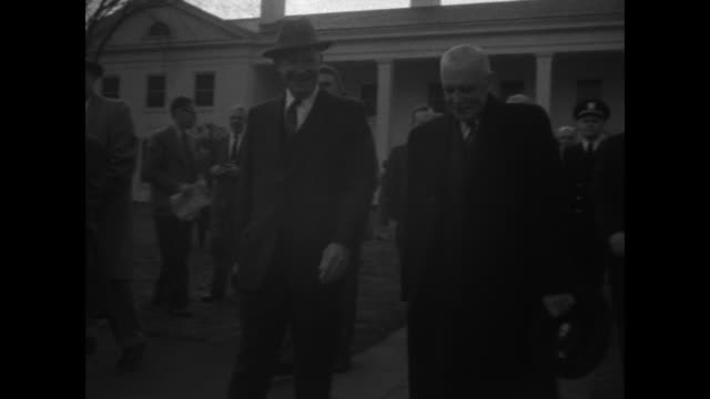 us president dwight d ike eisenhower and canadian prime minister louis st laurent exit the greenbrier resort and pose for photo op / joined by... - west virginia us state stock videos & royalty-free footage