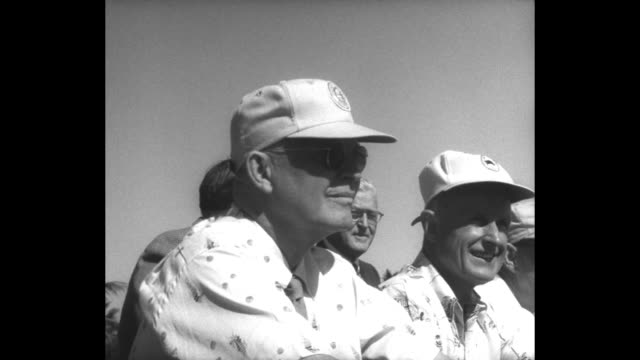 stockvideo's en b-roll-footage met us president dwight eisenhower chats with man as they sit with other men on wooden bleachers at baseball field eisenhower laughs / eisenhower and... - geheime dienstagent