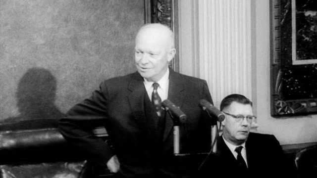 president dwight eisenhower holds final press conference / pressmen adjust cameras in preparation of press conference / eisenhower enters the room... - income tax stock videos and b-roll footage