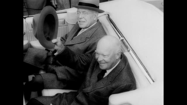 vídeos de stock, filmes e b-roll de / president dwight eisenhower nodding waving and tipping his hat to the crowds gathered on the harrisburg streets for his homecoming / eisenhower... - dwight eisenhower