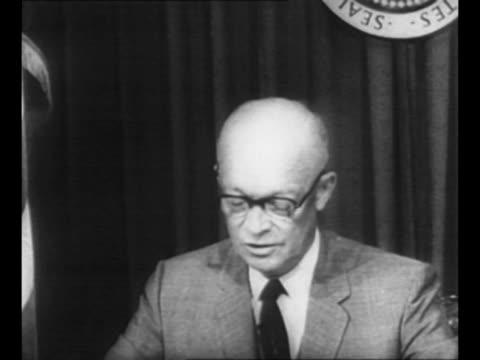 vídeos de stock, filmes e b-roll de us president dwight eisenhower sits at desk wearing eyeglasses and speaks into microphone sot re possibility of valuable scientific knowledge being... - dwight eisenhower