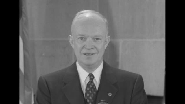 vídeos de stock, filmes e b-roll de president dwight eisenhower stands at podium with microphones on it and speaks to camera about resolution to defend rights the sinking of the ss... - dwight eisenhower