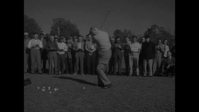 president dwight eisenhower walks with men caddy / ms president practicing hitting balls several golf balls on golf green people probably journalists... - golf bag stock videos & royalty-free footage