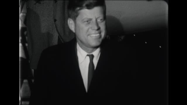 president eisenhower and john f kennedy deplane at airport - エアフォースワン点の映像素材/bロール