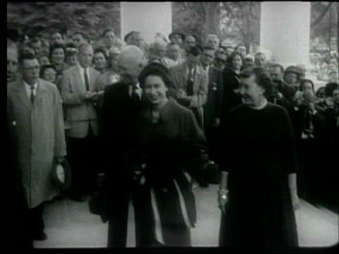 president eisenhower and mamie greet queen elizabeth ii and prince philip outside the white house. queen elizabeth ii visits washington dc on october... - 1957 stock-videos und b-roll-filmmaterial