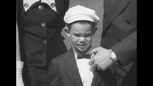 ms president eisenhower and son john sheldon eisenhower with little dwight david standing outside wearing sunday suits david pulls out a toy gun from... - toy gun stock videos & royalty-free footage