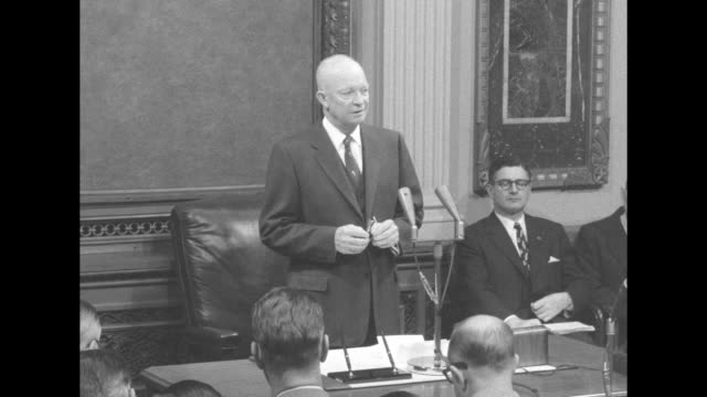president eisenhower stands at head of table with two microphones on stand in front of him, two men seated by wall; he opens with reference to... - farm to table stock videos & royalty-free footage