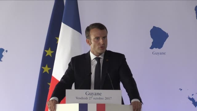 vídeos de stock e filmes b-roll de president emmanuel macron seeks to reassure the guyanese by saying that the state would respect its commitment to invest more than one billion euros... - territórios ultramarinos franceses