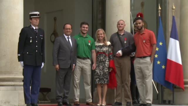 President Francois Hollande bestowed France's highest honour on a group of Americans and a Briton on Monday saying the whole world 'admires their...
