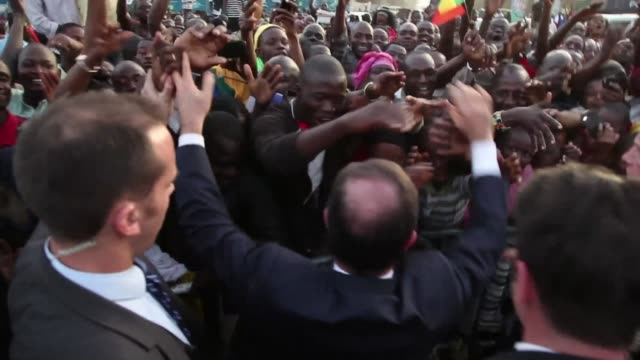 president francois hollande received a rapturous welcome in mali on saturday as he promised that france would stay as long as necessary to continue... - françois hollande stock videos & royalty-free footage