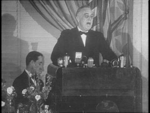 president franklin d roosevelt addresses banquet guests and radio audience from lectern - anno 1941 video stock e b–roll
