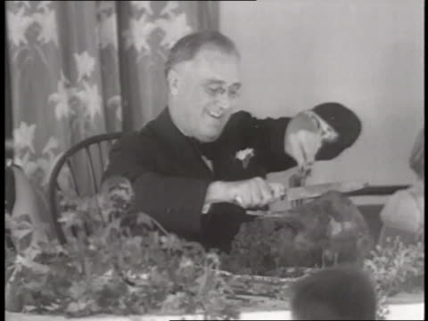 president franklin d roosevelt carves a turkey at a table during thanksgiving - 1930 stock videos & royalty-free footage