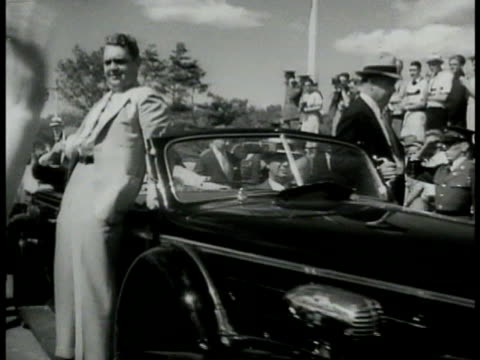 parade president franklin d roosevelt in convertible car w/ canadian prime minister mackenzie king fdr tipping hat to crowd ws large crowd w/ stage... - anno 1938 video stock e b–roll