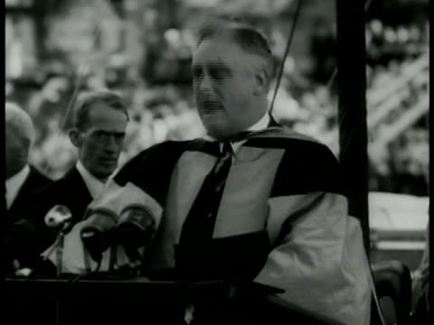 president franklin d roosevelt in robes 'the dominion of canada us will not stand idly by threatened by any other empire' standing crowd w/ some in... - anno 1938 video stock e b–roll