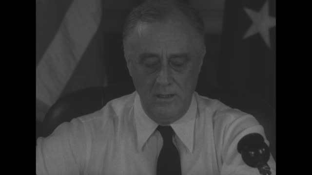president franklin d roosevelt, seated at desk in shirt and tie, calls for used rubber for recycling during wwii as he speaks into microphone - shirt and tie stock videos & royalty-free footage