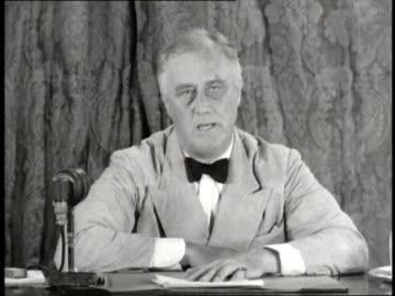 president franklin d. roosevelt sits at a desk and makes a speech about social security. - 1937 bildbanksvideor och videomaterial från bakom kulisserna