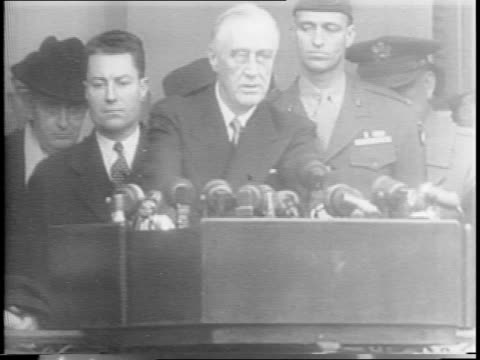 vídeos de stock e filmes b-roll de president franklin d roosevelt sits at desk / people arrive at white house / joseph grew lord and lady halifax / wounded servicemen from walter reed... - edward stettinius