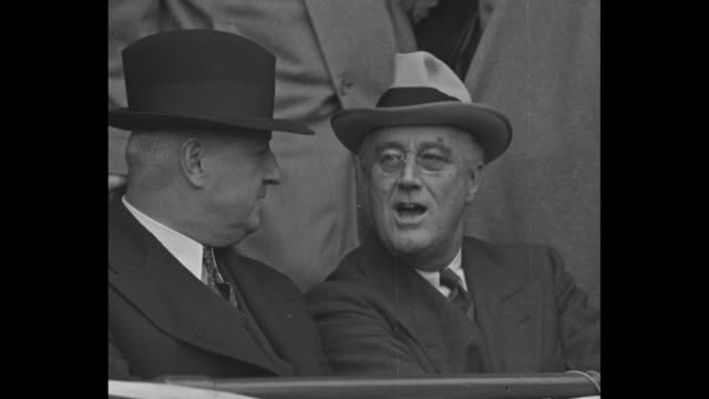 President Franklin D Roosevelt sits in audience at Washington Senators vs Boston Red Sox game on opening day / various shots of Roosevelt sitting and...