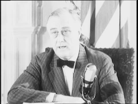 stockvideo's en b-roll-footage met president franklin d roosevelt sits near microphone, addresses nation / roosevelt claims enlisting in the armed forces is a privilege and not a... - in dienst gaan