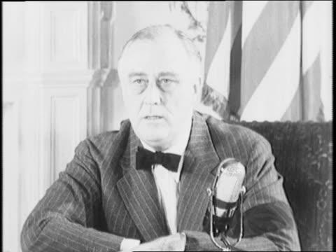 stockvideo's en b-roll-footage met president franklin d roosevelt sits near microphone and addresses nation / roosevelt states that victory is imminent - geallieerde mogendheden