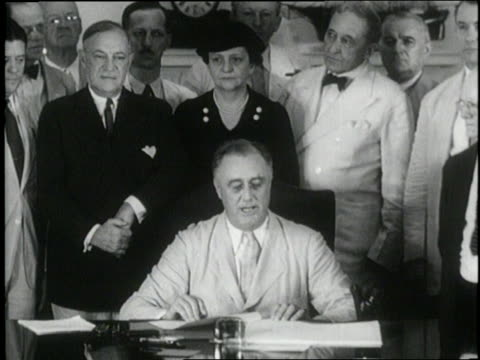president franklin d. roosevelt speaks about social security, unemployment insurance, and pensions after signing the social security act. - 社会保障点の映像素材/bロール
