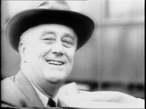 vídeos y material grabado en eventos de stock de president franklin d roosevelt tours american defense areas / roosevelt rides through street and warehouse in car / closeup of fdr in profile / tanks... - franklin roosevelt
