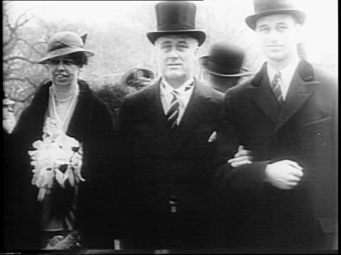 president franklin d roosevelt's birth and death date / photo of fdr / flag flaps in wind with capitol dome in background / crowds line sidewalks,... - franklin roosevelt stock videos & royalty-free footage