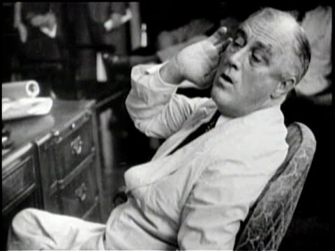 president franklin delano roosevelt speaks to a large crowd of reporters and politicians from his desk / various shots of signs all warning of... - franklin roosevelt stock videos & royalty-free footage