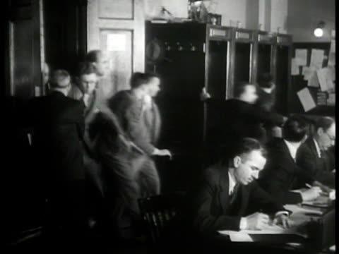 stockvideo's en b-roll-footage met president franklin 'fdr' roosevelt signing papers. vs reporters rushing out of room to press telephones. proclamation of bank holiday. int vs people... - 1933