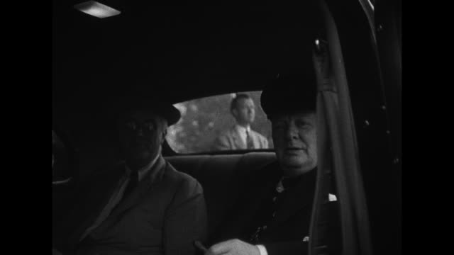 President Franklin Roosevelt and British Prime Minister Winston Churchill in back seat of car / MS reverse angle showing Roosevelt Churchill in car
