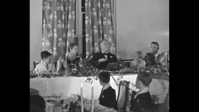 president franklin roosevelt and first lady eleanor roosevelt sit at table during thanksgiving dinner at the georgia warm springs foundation children... - us president stock videos & royalty-free footage