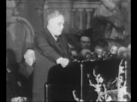 US President Franklin Roosevelt delivers speech at Madison Square Garden in NYC / side view crowd applauds / Roosevelt in open car with NY Governor...