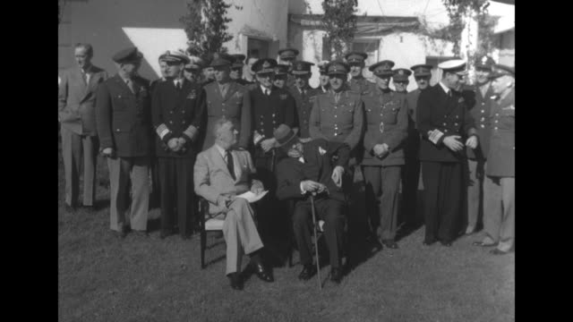 us president franklin roosevelt on left and british prime minister winston churchill sitting in chairs outside the anfa hotel posing for photo... - 1943 stock-videos und b-roll-filmmaterial