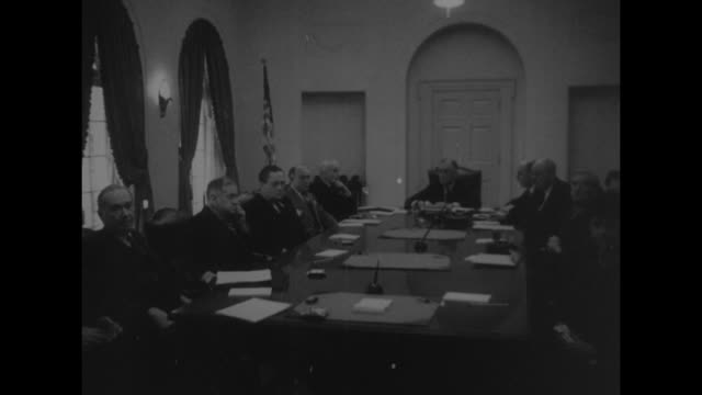 US President Franklin Roosevelt presides over meeting with his cabinet including Secretary of State Cordell Hull on his right and Secretary of the...