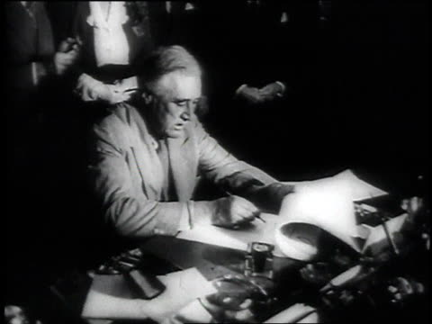 President Franklin Roosevelt signing a bill at his desk / Washington District of Columbia United States