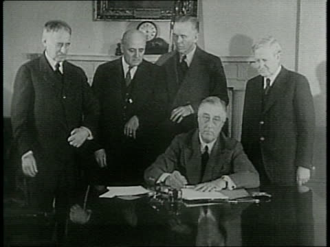 president franklin roosevelt signs the peacetime conscription bill from the white house in 1940 / secretary henry stimson representative may general... - peacetime stock videos & royalty-free footage