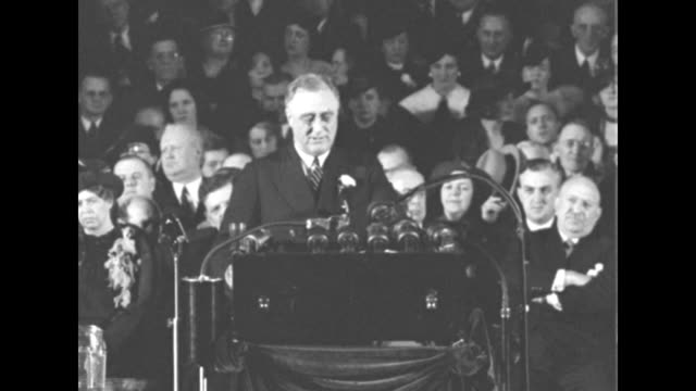 president franklin roosevelt speaking at podium with microphones in front can see eleanor roosevelt seated behind sots regarding administration... - new deal video stock e b–roll