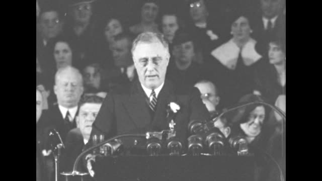president franklin roosevelt speaking behind podium with microphones can see faces of audience members behind him sots re private enterprise should... - new deal video stock e b–roll